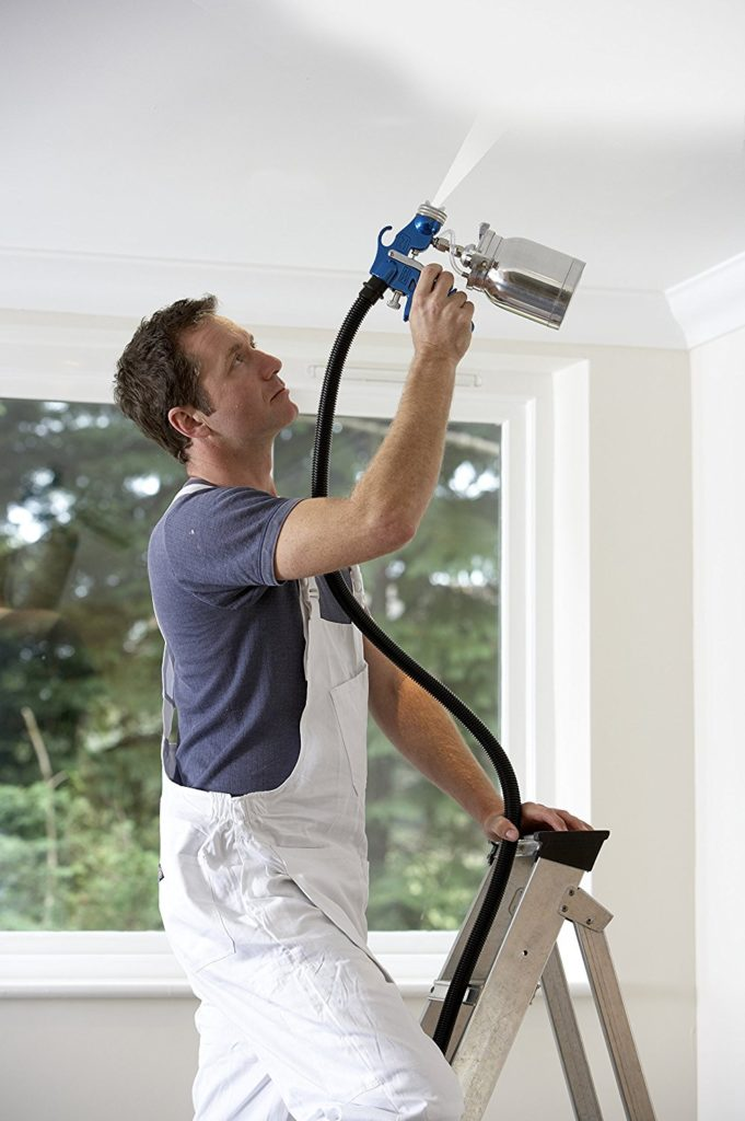 Man painting ceiling with earlex paint sprayer