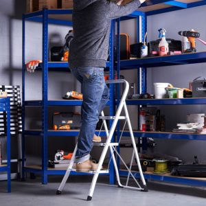 Man standing on portable step ladder