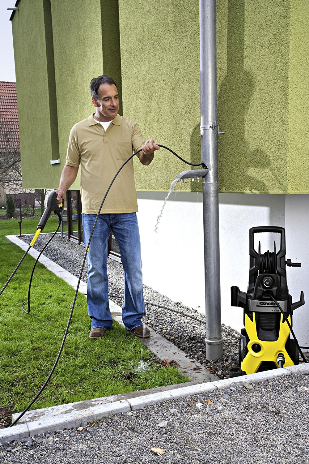 Man using pipe cleaning kit pressure washer
