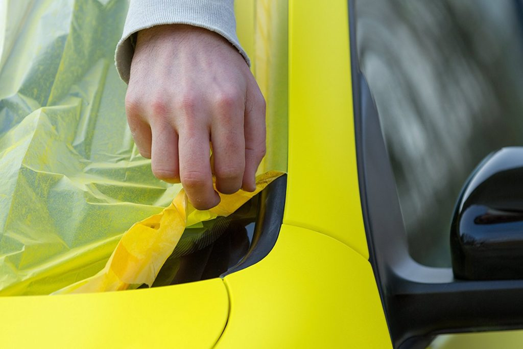 Using paint sprayer to paint car yellow