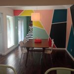 Wall painted multicolour using masking tape