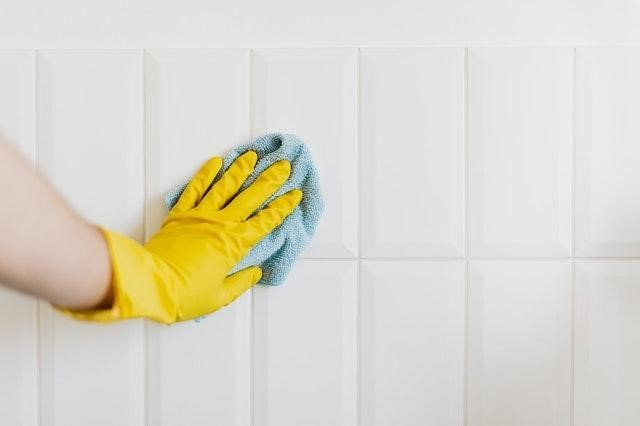 Wiping Tiles On Wall